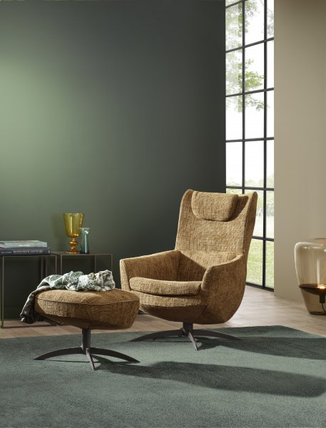Griffon | Elegant nestling in a surprisingly compact lounge chair | JORI